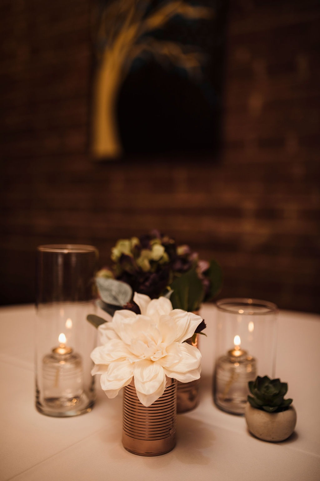 Industrial wedding centerpieces with metal cans and light bulbs